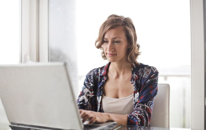Woman working from home on her laptop